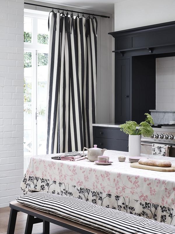 Ian Mankin - Kitchen - Tablecloth in Kew Baltic Pink, Charcoal, Curtain in Devon Stripe Black, chair cover in Ticking 02 Black - Portrait