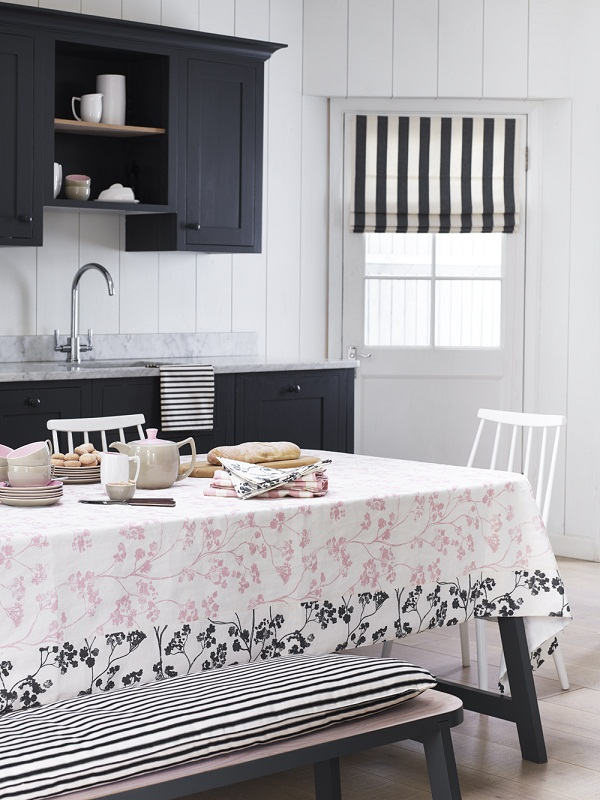 Ian Mankin - Kitchen - Tablecloth in Kew Baltic Pink, Charcoal, chair cover in Ticking 02 Black, roman blind in Devon Stripe Black - Portrait