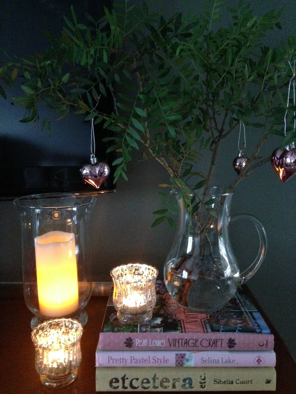 Dear Designer's pared back Christmas with lots of foliage and candles