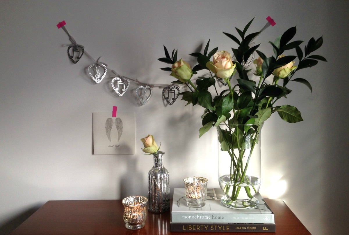 Dear Designer's pared back Christmas with roses, mercury glass and a silver garland [1]