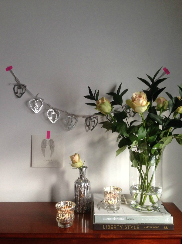 Dear Designer's pared back Christmas with roses, mercury glass and a silver garland
