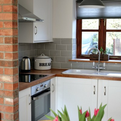 country kitchen, white shaker cabinets, grey metro tiles