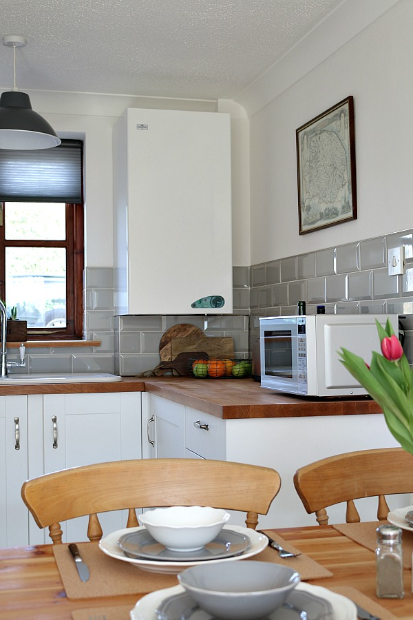 country kitchen, grey metro tiles, white shaker cabinets