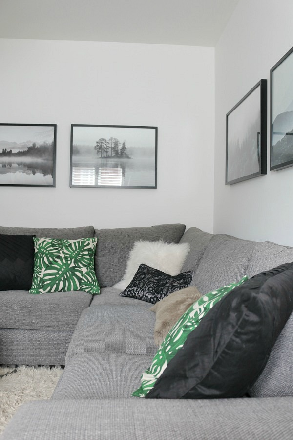 grey corner sofa, botanical print cushions