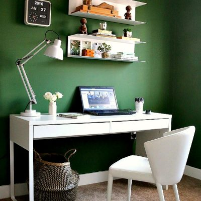 home office with green walls, white furniture and lots of lovely plants