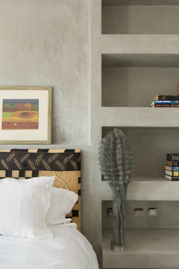 house tour, London, bedroom with washed and polished plaster walls, integral shelves.