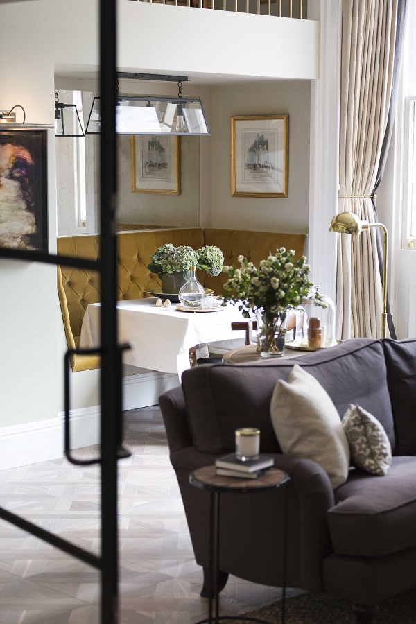 a cosy little dining nook with banquette seating