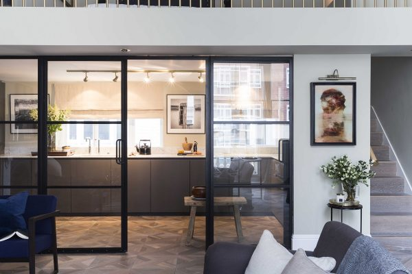 crittall doors divide the living space from the kitchen
