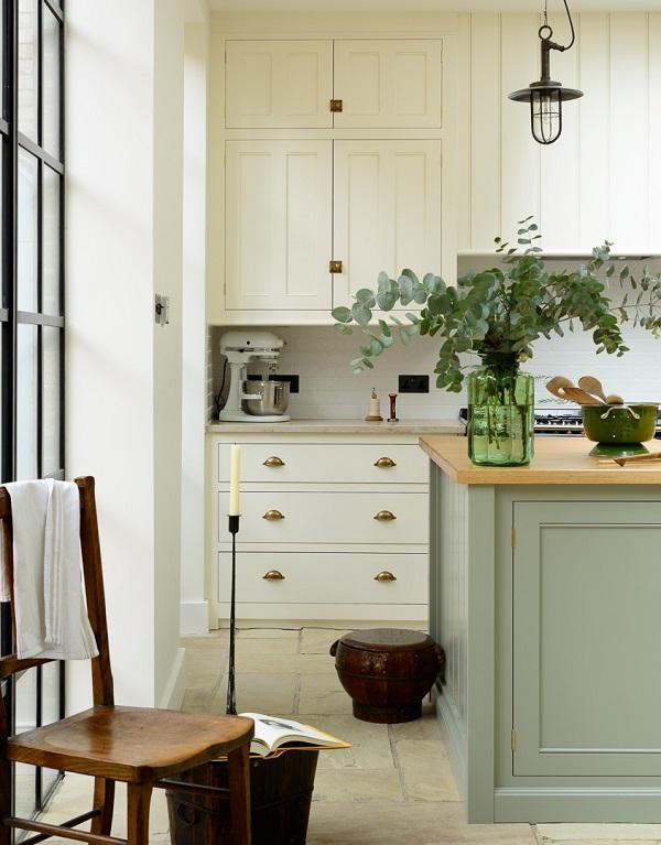 Traditional cabinets+warm oak+flagstones+aga=classic English kitchen