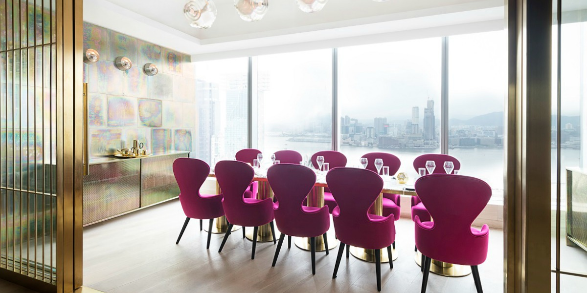 metallic walls and plush pink seating almost detract from the spectacular view