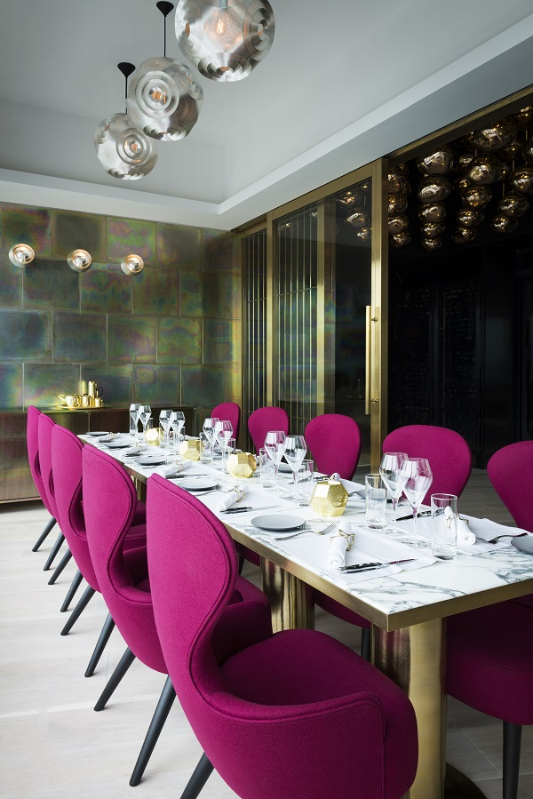 metallic walls and luxurious pink seating