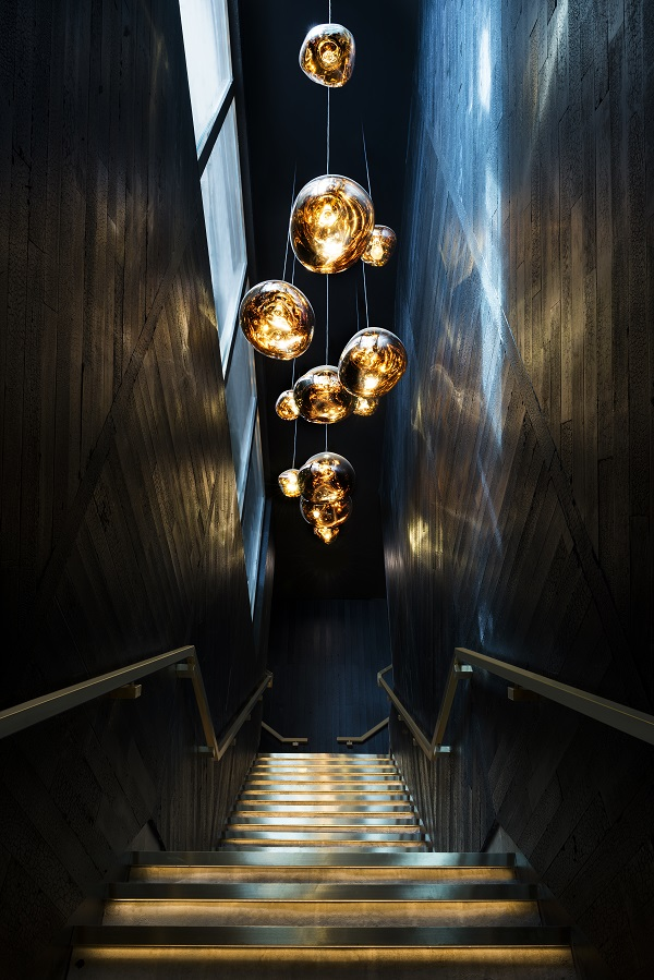 stunning pendants light a narrow black staircase