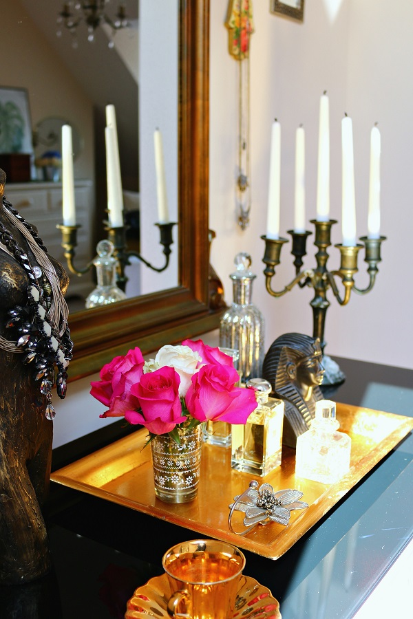 Add some glamour to the dressing table with some deep pink roses