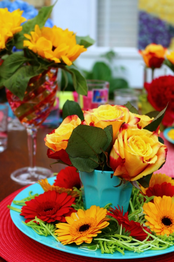 Use colourul flowers to decorate the table when entertaining