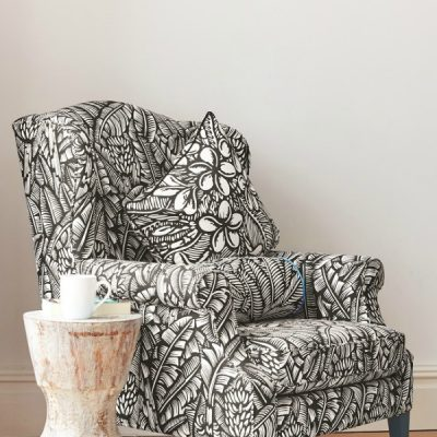 Black and white patterned wing back armchair. Ethnic design from Cambodia