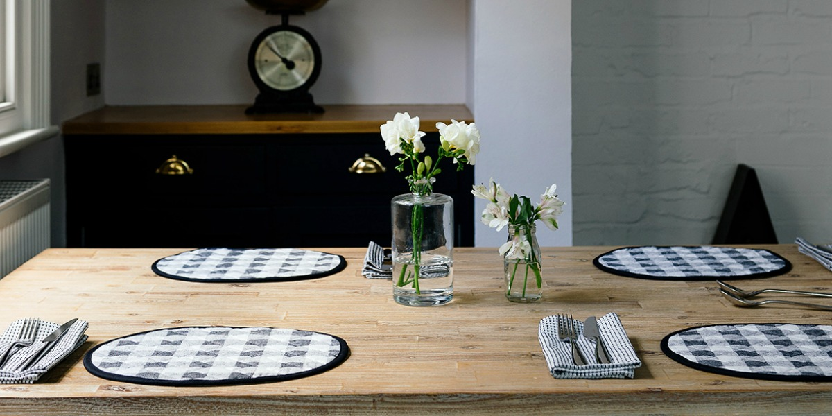 black check table linen needs just a few springs of flowers to set a simple country scene