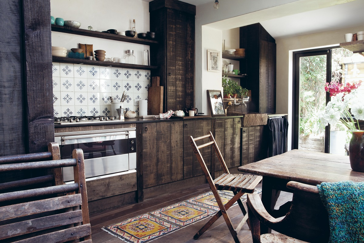 Love a rustic kitchen with dark wood cupboards and patterned wall tiles
