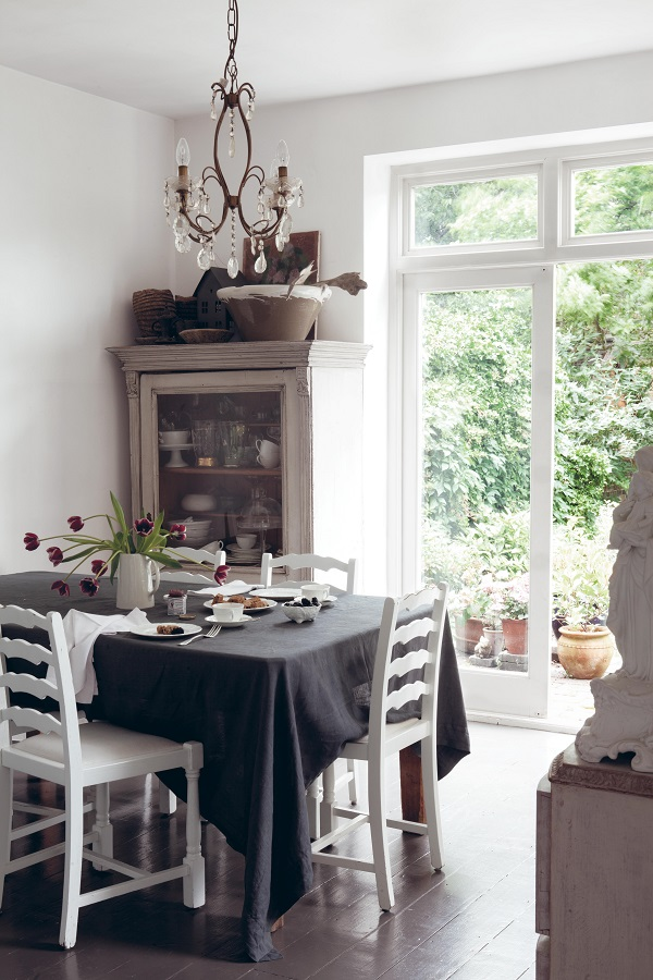 dining room featuring linen and french country furniture