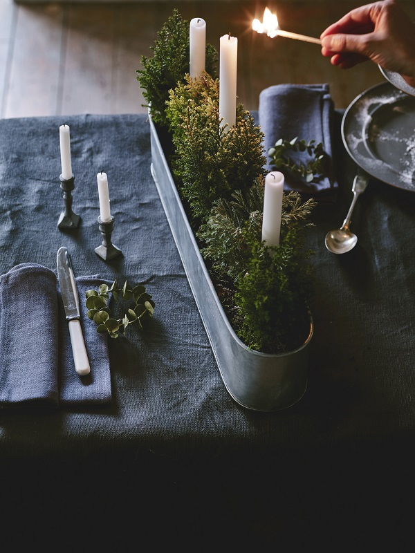 Conifers and candles. A simple idea for an autumnal table setting