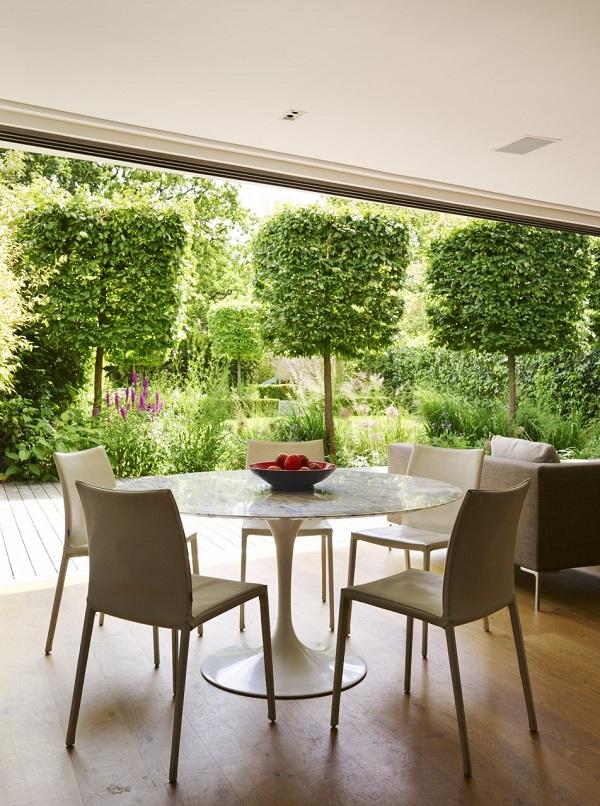 cube-cut beech trees in the manicured garden