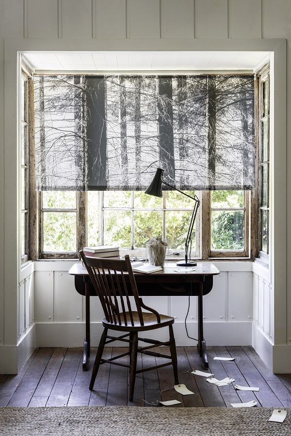 Nordic inspired forest scene on a window blind