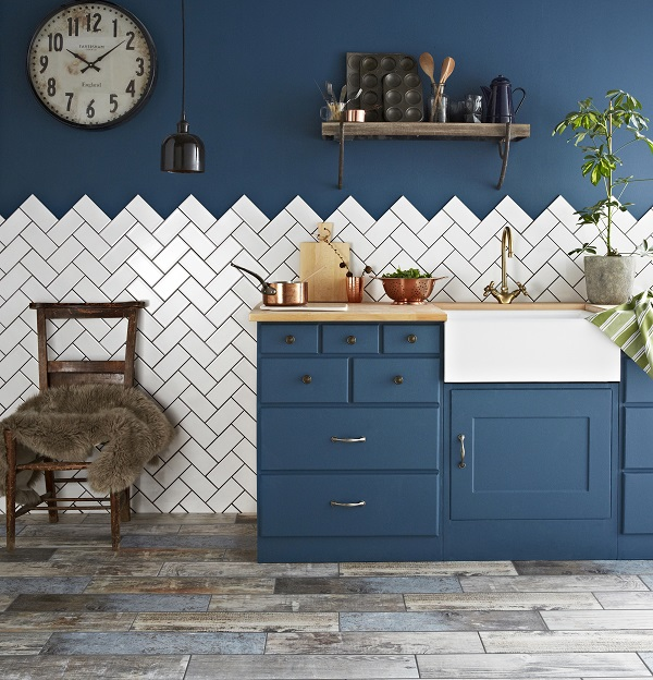 Plain white metro tiles laid in a herringbone pattern