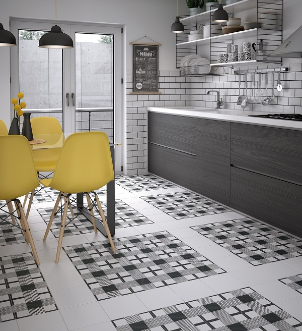 Black and white patterned floor tiles broken up with plain white