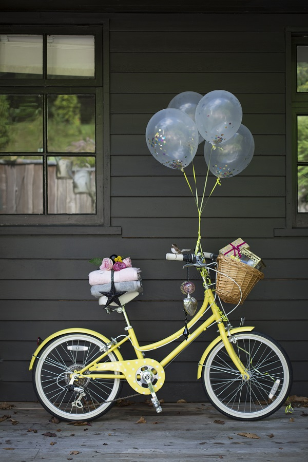 Create a special welcome this Christmas. Bike, balloons and presents optional