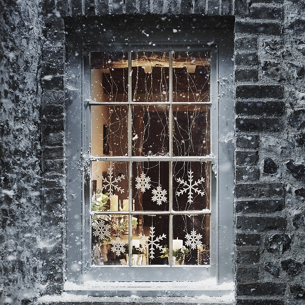 Christmas decorations = snowflakes in the window and twinkling lights