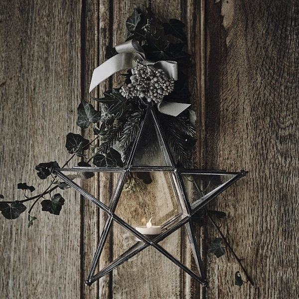Christmas decorations - a star lantern and a posy of greenery