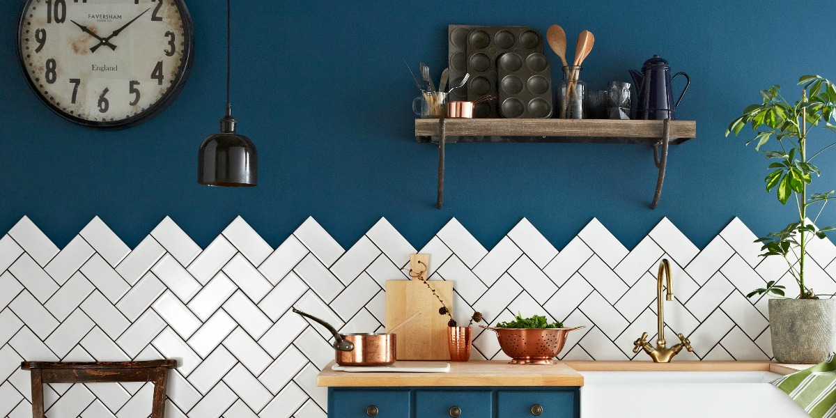 White metro tiles laid in a herringbone pattern