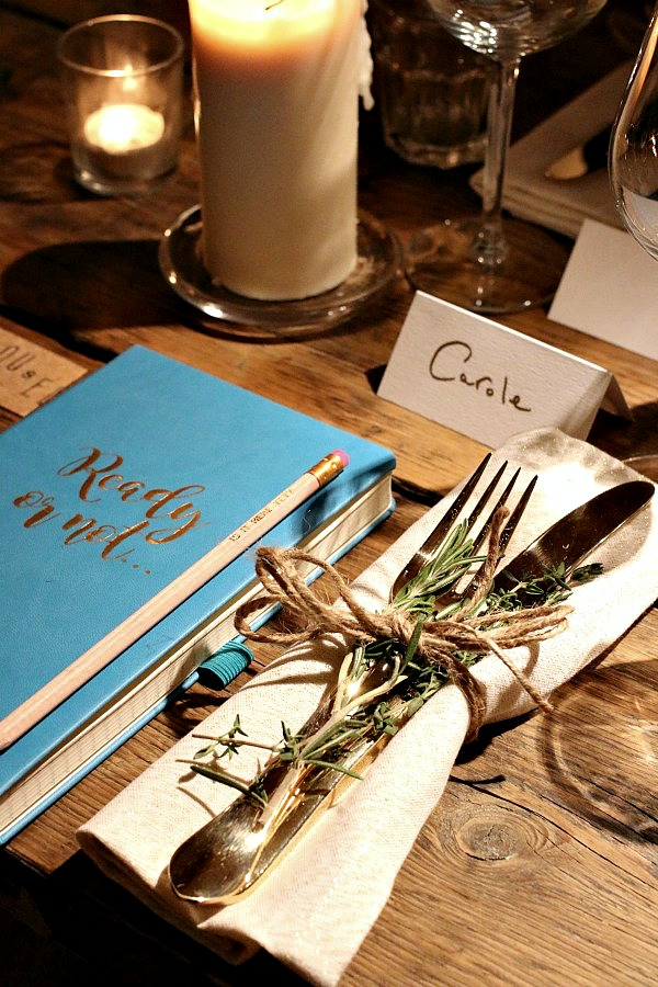 Simple and chic - cutlery and napkins tied with string and decorated with a sprig of rosemary