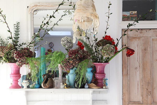 flower filled mantle - collection of vases