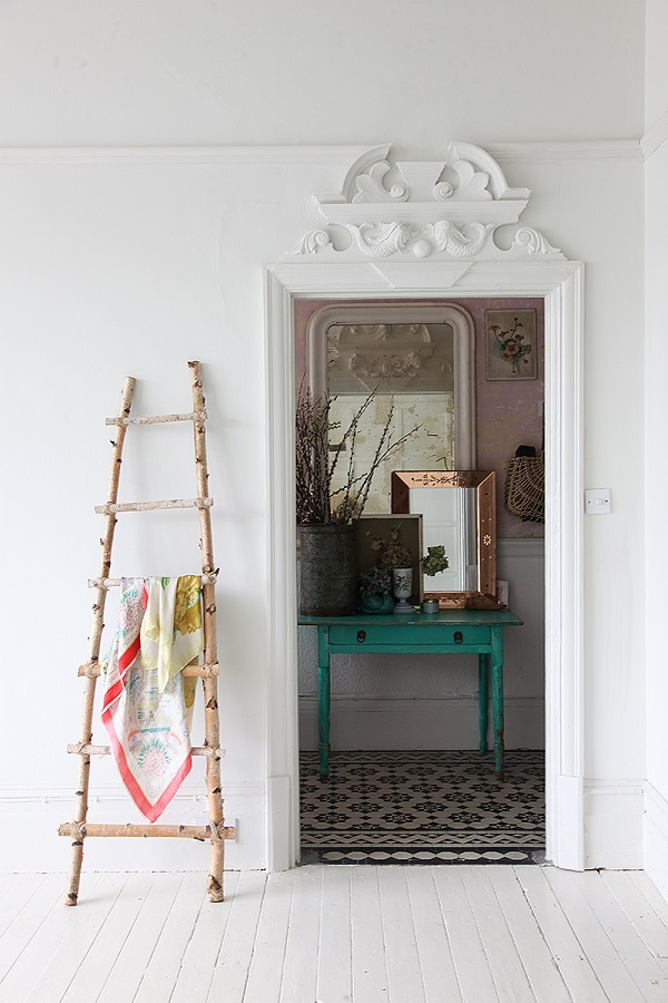 Fabulous period details above a door - a peak into a shabby chic bedroom