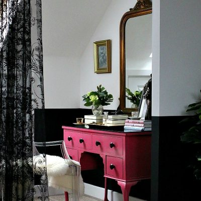 Master Bedroom Suite - pink dressing table, black lace, sheepskin