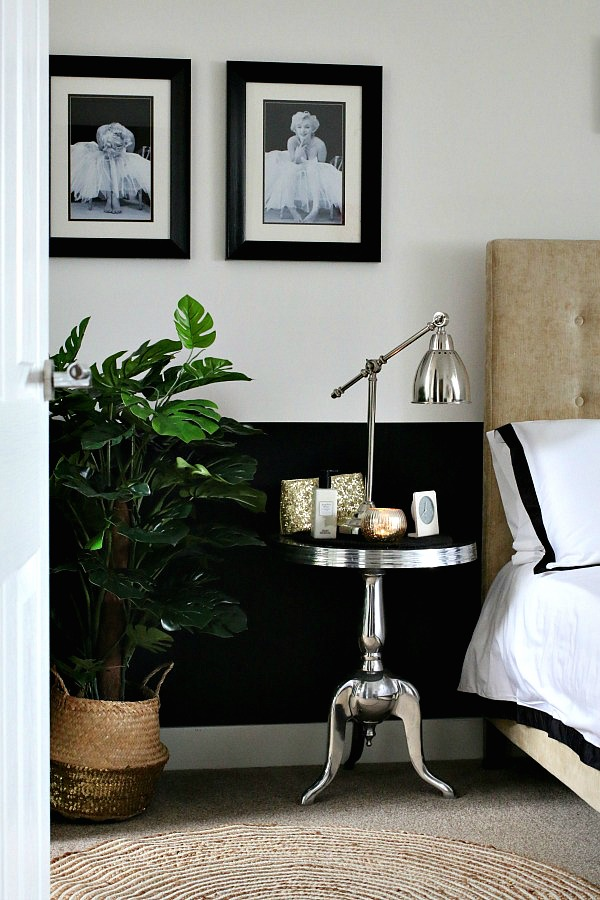 Master Bedroom suite, black and white walls, faux cheese plant, silver bedside table
