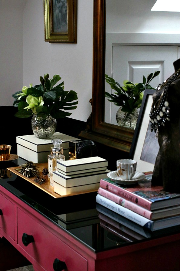 Master bedroom suite - pink dressing table, black and white walls