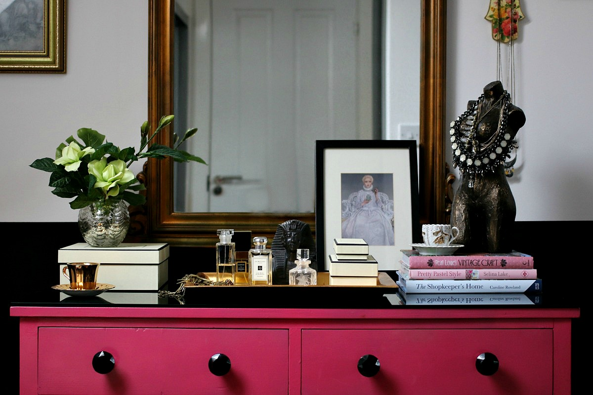 Master Bedroom Suite - pink dressing table, large mirror, faux flowers