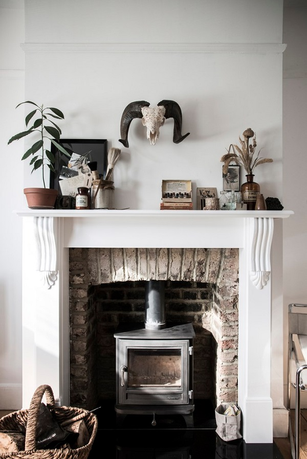 Fireplace ideas - wood burner + plants + collections of blogger and photographer Carole Poirot