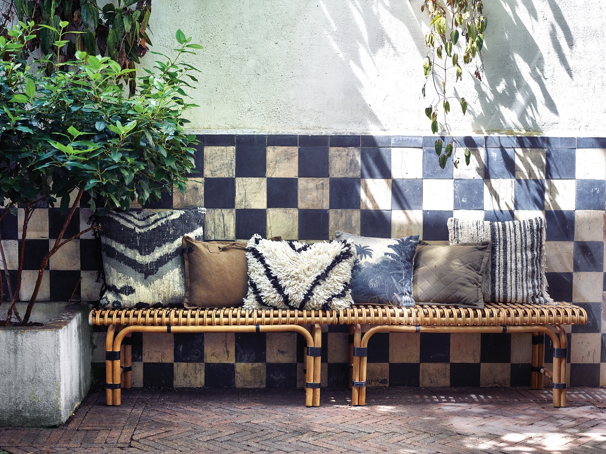 Bringing Conservatory Chic into the home with rattan furniture, tiles and plants