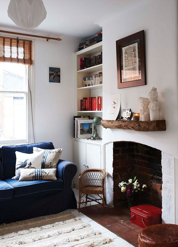 Fireplace ideas - a simple rustic wooden mantle, candles and lanterns