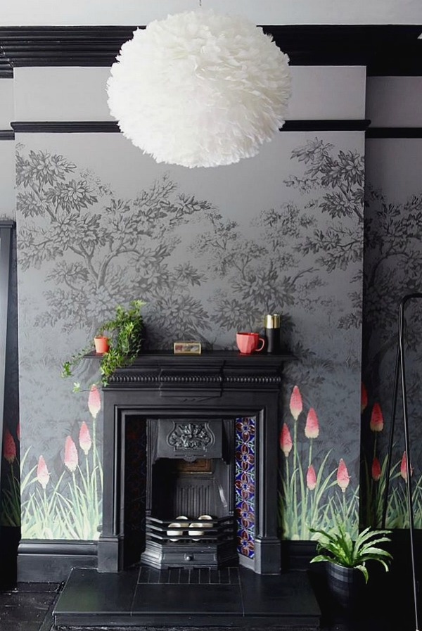 Fireplace ideas - a striking wallpaper in black and grey with coral accents