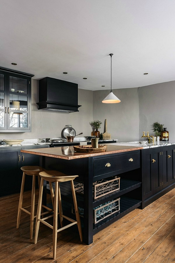 Shaker range of kitchen cupboards have been painted a delicious black