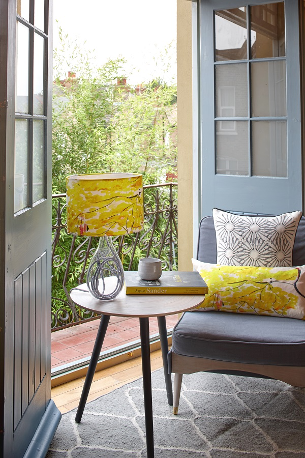 Using yellow in home decor as accent colours on lampshades and cushions