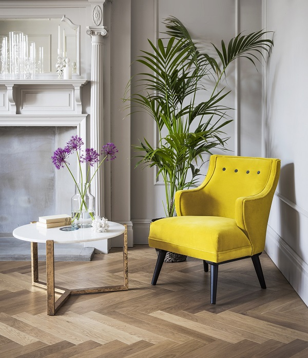 using yellow in home decor with a single yellow velvet chair