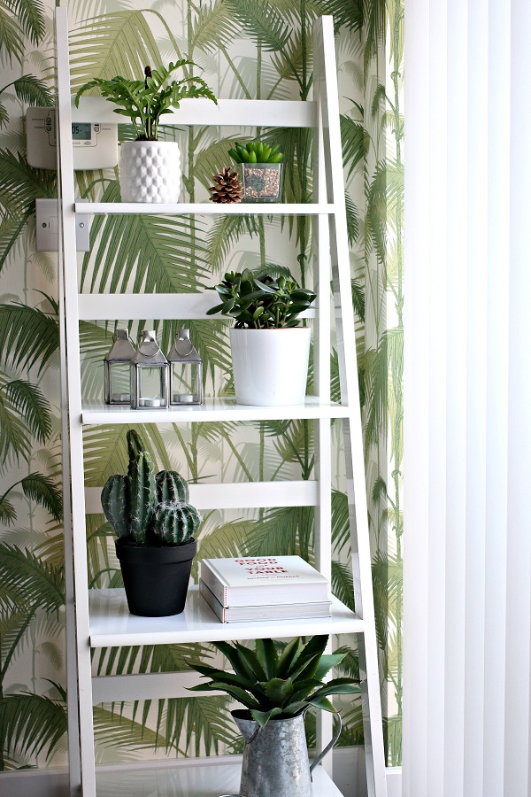 Kitchen makeover with palm print wallpaper and lots of plants