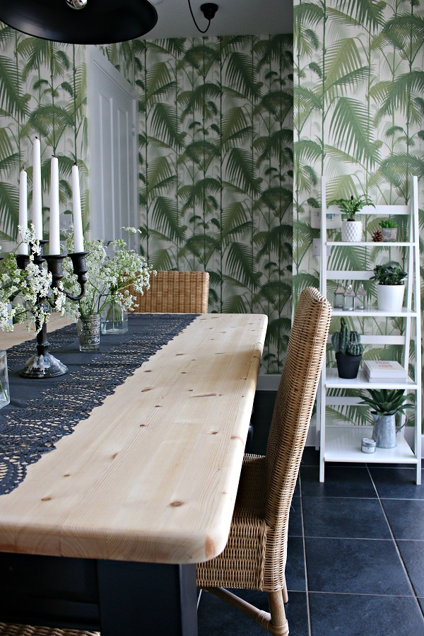 palm print wallpaper and rustic looking table in my kitchen makeover