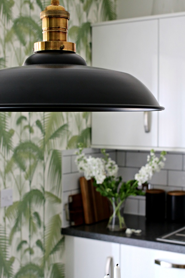 Black pendant light and tropical wallpaper in my kitchen makeover
