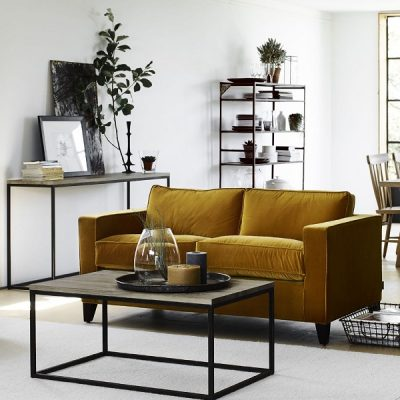 Using yellow in the home with a stunning mustard velvet sofa