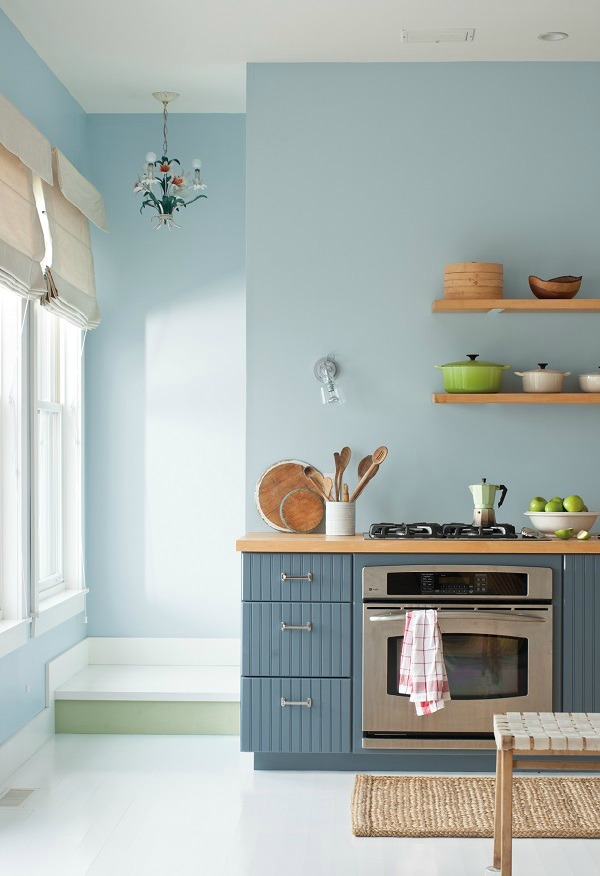 Paint a Kitchen in shades of blue complemented by pale wood for a Scandinavian feel